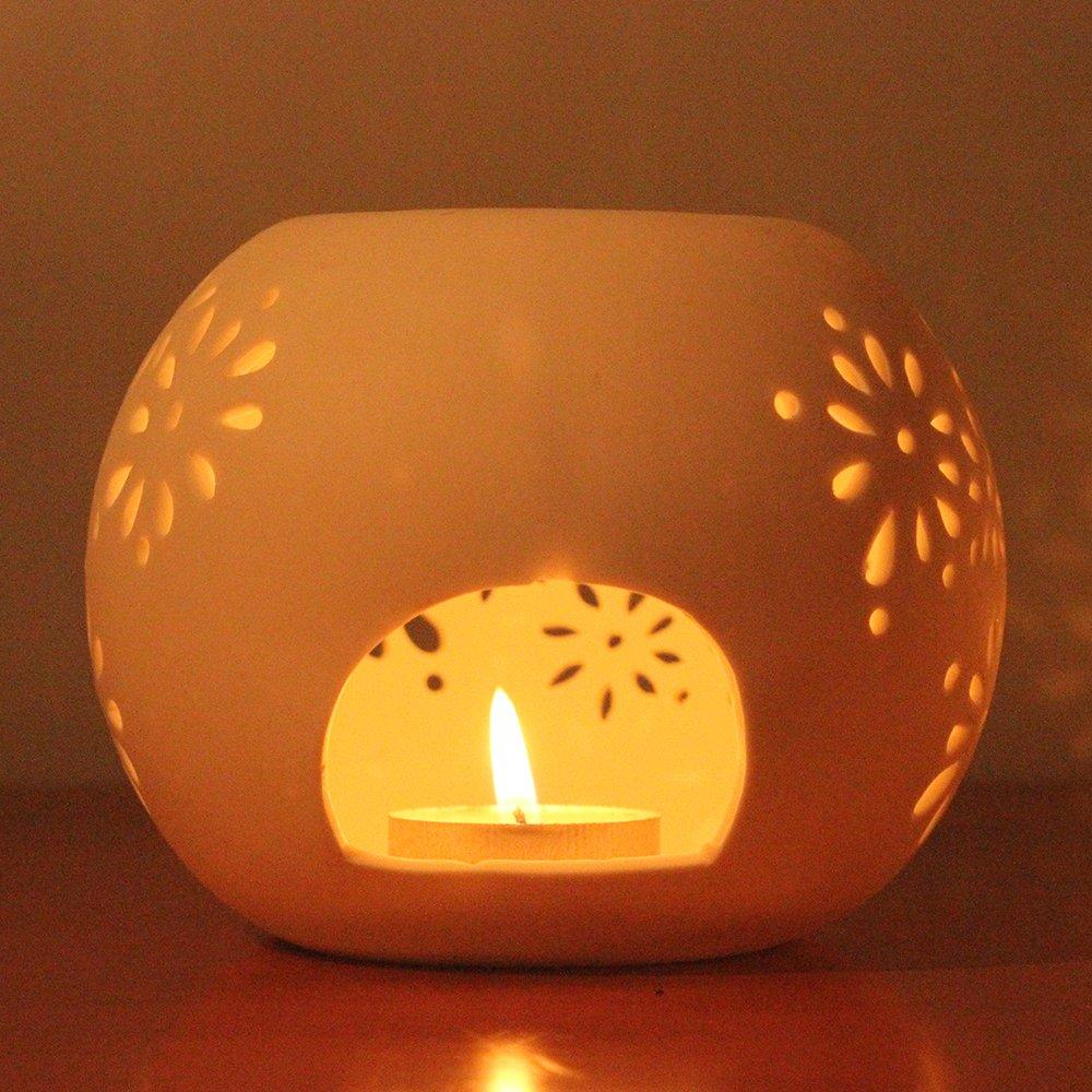 雅香阁 创意家居摆件 陶瓷白色镂空蜡烛光 香薰精油灯